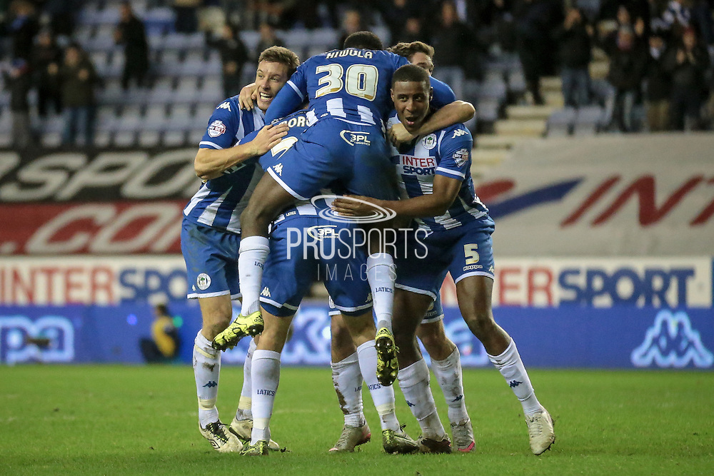 Wigan celebrate the winning goal during the Sky Bet League 1 match between Wigan Athletic and Gillingham at the DW Stadium, Wigan, England on 7 January 2016. Photo by Mark P Doherty.