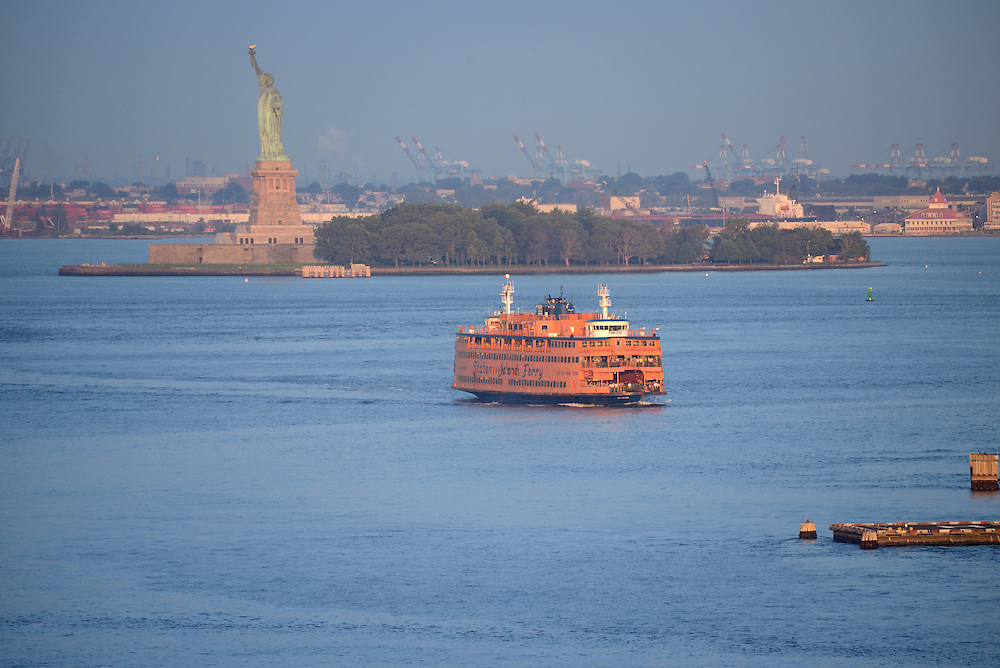 USA, America, New York, East River , state isand ferry in front of statue of liberty in New York harbor,