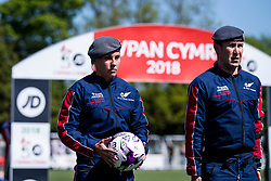 NEWTOWN, WALES - Sunday, May 6, 2018:  Flight Lieutenant Mikaela Harrison holds the match ball as the RAF Falcons display parachuting team stand to attention on the pitch before the FAW Welsh Cup Final between Aberystwyth Town and Connahs Quay Nomads at Latham Park. (Pic by Paul Greenwood/Propaganda)