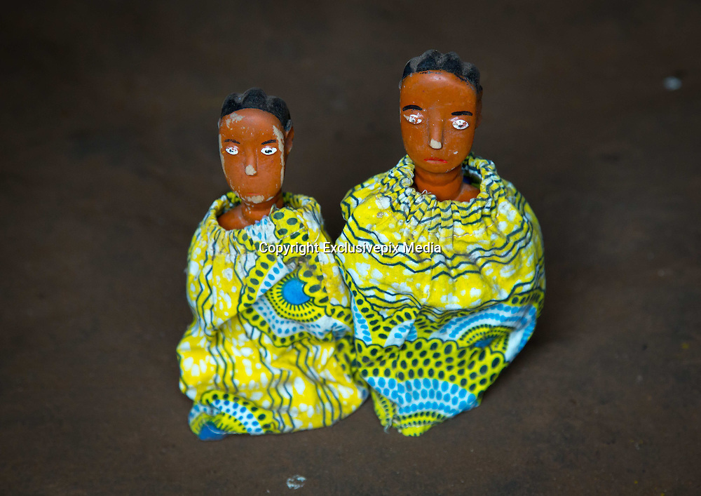 Benin&rsquo;s Living Dead: The Voodoo Twins Tradition<br /> <br /> 40% of the world&rsquo;s twins are born in Africa. Benin&rsquo;s Fon people have one of the highest occurrences at 1 in 20 births. The high rate of infant mortality and voodoo religion, Benin&rsquo;s national religion, have begot some very particular practices concerning the deaths of one or both of these twins. In many other societies, twins are regarded as bad omens and often killed or abandoned at birth. However, in the Fon culture, twins have always been revered because Nana Buluku, voodoo&rsquo;s androgynous creator of the universe, gave birth to twins. These twins in turn created the voodoo deities that run the world.<br /> <br /> Once a twin dies, a wooden statue called the &ldquo;hohovi&rdquo; is carved, within which the spirit of the dead child is placed. These figurines are deified and treated almost exactly like the living children. For the Fon, twins are immortal. They continue to live even after their death, bringing blessings or misfortune depending on if there are either pampered or abused.<br /> <br /> Three months after the birth of twins, if they are still living, the parents go collect gifts from other members of their community. If one or both of the twins die, then the mother carries the statues around between her breasts and walks around with a tray on her head, receiving alms for the twins.  All donate some money or food. The mother may even take some wares on display at the market. If a woman is rich or powerful, then she sends someone to conduct this collection in her place. <br /> <br /> In Bopa, a village situated on the banks of Lake Aheme in southern Benin, Dah Tofa and his wife reside. Dah Tofa, an educated man in his 60s, is a voodoo priest. His wife, who is around 40 years old, speaks only Fon. I ask for her name and she tells me the name she was born with, but this causes a bit of an incident. Her husband explains that she was supposed to say &ldquo;Hounyoga&rdquo;, the name of the voodoo goddess she worships whose name she took. Her husband tells me