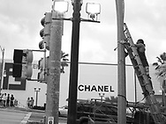 Fixing street lamps opposite the Chanel store in Tumon, Guam, on Saturday, Mar. 10, 2007.  Sometimes known as 'America in Asia', Guam is a popular destination for Japanese tourists ( accounting for approx 90% of the island's visitors) with average visitor numbers from Japan approaching 1million.  The island, a 3.5 hour flight from Japan, has more than 20 large hotels and numerous duty-free shopping malls catering to the Japanese tourists predilection for designer brand name goods, as well as golfing and other water based entertainment features. In 2007-2008 US military personal currently stationed in the Japanese Okinawan Islands will relocate their bases and operations  to Guam, helping to stabilise the island's economy which suffered after tourism decreased in recent years due to a  fear of flying by Japanese post 9-11 World Trade Centre disaster, a 2003 typhoon and the SARS disease outbreak in Asia.
