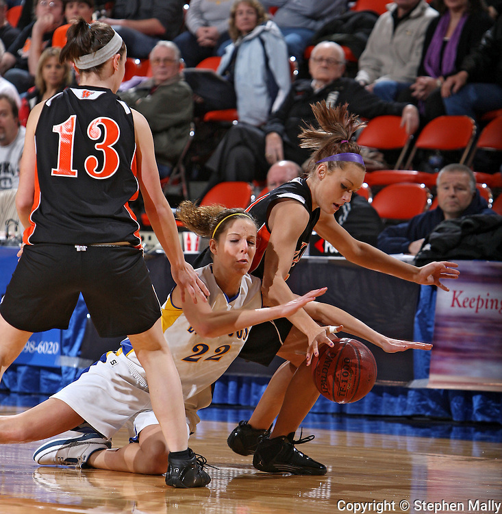 MFL-MarMac's Chelsey Lamker (22) and Waukon's Jordan Reiser (31) battle for a lose ball during their Rivalry Saturday game at the US Cellular Center in Cedar Rapids on Saturday January 2, 2010. Waukon defeated MFL MarMac 48-38 for Coach Gene Klinge's 939th career victory. (Stephen Mally/Freelance)