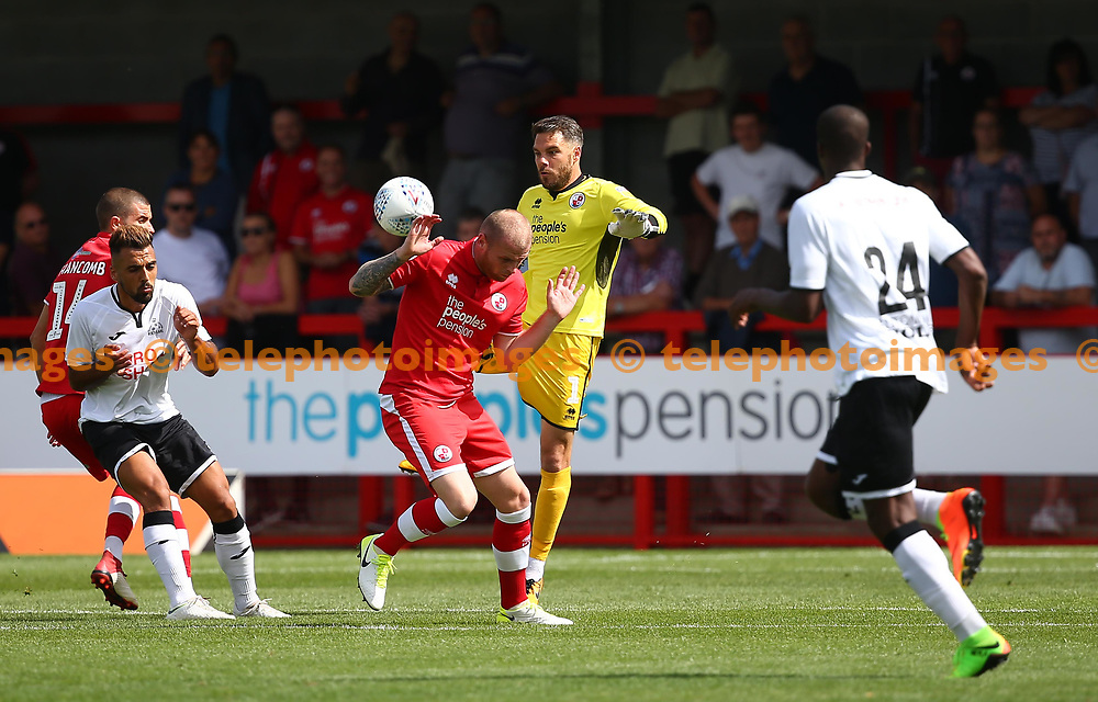 Crawley's Glenn Morris  clears the ball during the pre season friendly between Crawley Town and KSV Roeselare at The Broadfield Stadium, Crawley , UK. 28 July 2018.