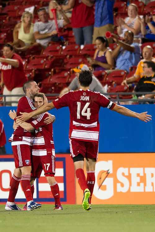 FRISCO, TX - JUNE 12:  Zach Loyd #17 of FC Dallas celebrates with teammates Eric Hassli #29 and George John #24 against the Houston Dynamo on June 12, 2013 at FC Dallas Stadium in Frisco, Texas.  (Photo by Cooper Neill/Getty Images) *** Local Caption *** Zach Loyd; Eric Hassli; George John