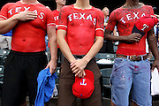 Left to right, Jake Tucker of Fort Worth, D.J. McLaughlin of Plano and Josh Polak of Waxahachie stand proudly wearing painted-on jerseys of their favorite players during the National Anthem before the Texas Rangers' game against the Minnesota Twins at Rangers Ballpark in Arlington August 25, 2010. (Courtney Perry/The Dallas Morning News) 08282010xMETRO.