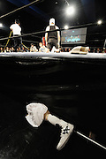 A prosthetic limb lies at ringside during a bout at Doglegs, an event for wrestlers with physical and mental handicaps in Tokyo, Japan.