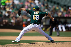 OAKLAND, CA - JULY 23:  Arnold Leon #68 of the Oakland Athletics pitches against the Toronto Blue Jays during the eighth inning at O.co Coliseum on July 23, 2015 in Oakland, California. The Toronto Blue Jays defeated the Oakland Athletics 5-2. (Photo by Jason O. Watson/Getty Images) *** Local Caption *** Arnold Leon