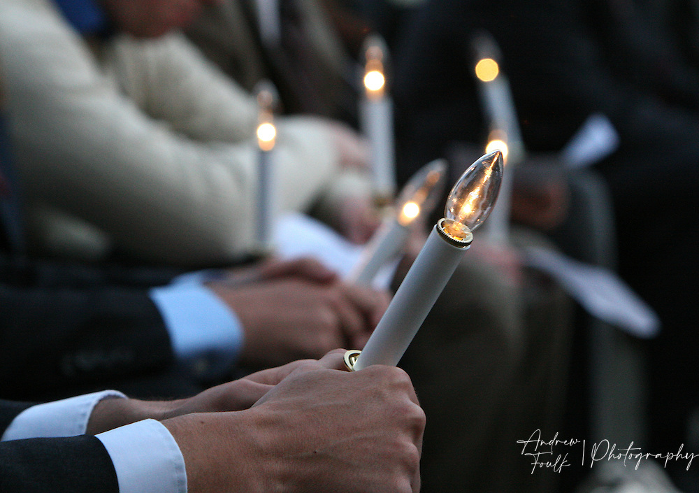 /Andrew Foulk/ For the Californian/.Family and friends of victims of violent crimes hold onto electric candle during  a candlelight vigil at the community recreation center in Temecula as part of National crime victims' rights week.