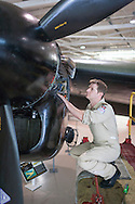 July 30, 2014. Hamilton, Ontario, Canada. The Canadian Warplane Heritage Museum will be flying their prized Avro Lancaster to England to join the only other airworthy Lancaster in the world, owned and operated by the Royal Air Force's renowned Battle of Britain Memorial Flight. Pictured is the flight crew member, Craig Brookhouse.<br /> Photo Copyright John Chapple / www.JohnChapple.com