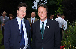 Left to right, GEORGE OSBORNE MP and DAVID CAMERON MP at the No Campaign's Summer Party - a celebration of the 'Non' and 'Nee' votes in the Europen referendum in France and The Netherlands held at The Peacock House, 8 Addison Road, London W14 on 5th July 2005.<br />