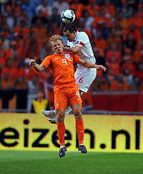 Dirk Kuyt of Holland and John Terry of England during the International Friendly between Netherlands and England at the Amsterdam Arena on August 12, 2009 in Amsterdam, Netherlands.