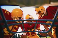 Football Players Huddling --- Image by © Jim Cummins/CORBIS