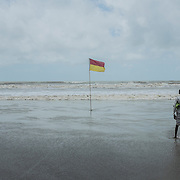 A man walk along Cox's Bazar's beach, Bangladesh