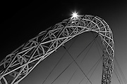 The Steel arch of Wembley stadium known as the 'Wembley arch' supports the roof structure is 134 meter (440 ft) high with a span of 317 metres (1,040 ft)Wembley stadium is the home venue of England's national football team. Capacity 90.000 seats, including standing places 105.000.<br />