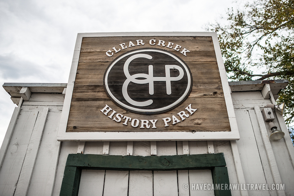 Sign at the main entrance of the Clear Creek History Park in Golden, Colorado, showing the historic frontier life of the region's early settlers.