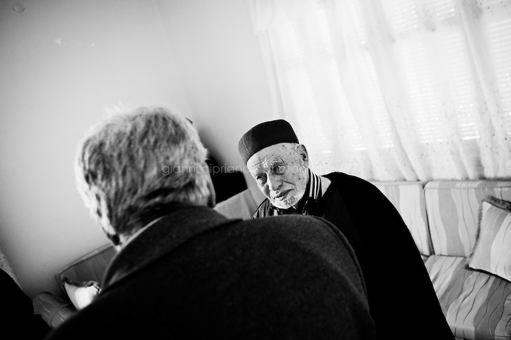 Kairouan, Tunisia - 18 December, 2011: Said Ferjani (left), 57, senior member of the political and communication bureau of the Nahda (Renaissance) party, discusses with his former high school professor Sheilkh Abdulwahab, 80, who joined the Nahda movement and was jailed under Ben Ali's regime, in Kairouan, Tunisia on 18 December, 2011. Said Ferjani started his activism in the Negra mosque of his hometown Kairouan when he was 16 years old, debating on politics, philosophy, economy and world events. In 1989 former dictator Zine El Abidine Ben Ali turned against Nahda (or Ennahda) and jailed 25,000 activists. Said Ferjani was jailed and tortured. He then flew Tunisia and moved to the UK. He came back to Tunisia after 22 years, after former dictator Ben Ali flew the country.<br /> <br /> Gianni Cipriano for The New York Times