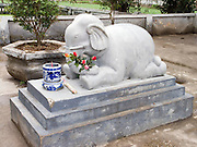 elephant statue with offerings of flowers & candle; park; Hanoi; Vietnam