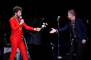 Comedian Will Ferrell and singer Sting perform during the Rainforest Foundation's benefit concert at Carnegie Hall in New York May 19, 2006. Photo By Keith Bedford