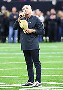 Jan 20, 2019; New Orleans, LA, USA; Musician and entertainer Jimmy Buffett performs the National Anthem before the NFC Championship at Mercedes-Benz Superdome between the New Orleans Saints and the Los Angeles Rams. The Rams beat the Saints in overtime 26-23 and head to Super Bowl 53 in Atlanta. (Steve Jacobson/Image of Sport)