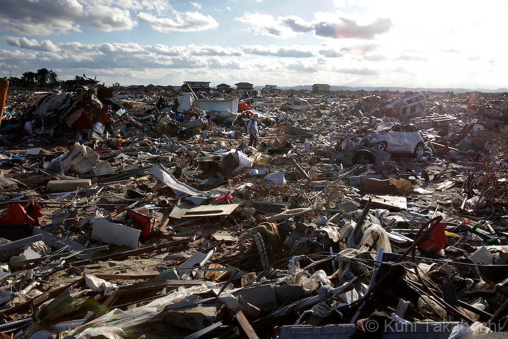 A man looks for his belongings in Arahama in Sendai, Miyagi, Japan on April 4, 2011 after massive earthquake and tsunami hit northern Japan. More than 20,000 were killed by the disaster on March 11.<br /> Photo by Kuni Takahashi