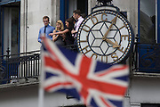 London, 10th September 2012. Office workers watch the Olympic parade from their City balcony as thousands of spectators lined the capital's streets to honour 800 of TeamGB's athletes and Paralympians. Britain's golden generation of athletes in turn said thank you to its Olympic followers, paying tribute to London and a wider Britain as up to a million people lined the streets to celebrate the ?greatest ever? sporting summer and billed to be the biggest sporting celebration ever seen in the UK.