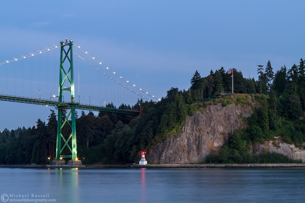 The Lions Gate Bridge and Stanley Park's Prospect Point Lighthouse at Stanley Park in Vancouver, British Columbia, Canada