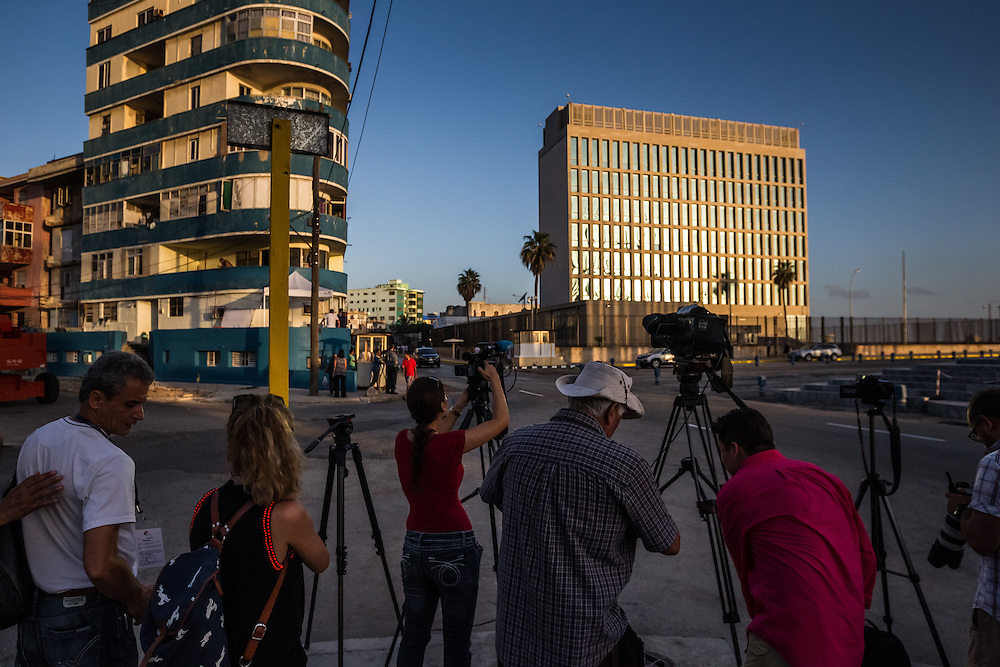 HAVANA, CUBA - JULY 20, 2015: Dozens of local and international journalists swarmed the embassy this morning. After more than half a century defined by mistrust and rancor, the United States officially reopened its six-story embassy in Havana today, marking a watershed moment of transition for the two countries as they lean toward closer diplomatic ties and ease past one of the last remnants of the Cold War.  President Barack Obama, when announcing an end to the diplomatic freeze, eased travel restrictions, opened the door for more remittances to Cuba and expanded the amount of goods that visiting Americans could bring back home – like Cuban cigars and rum. He even removed the country from the list of nations that sponsor terrorism. President Raul Castro, meanwhile, has spent the last five years, before the thaw even began with the Obama administration, attempting to alter his nation's economic dysfunction, ordering the firing of government employees, encouraging a slow but fresh influx of Cubans into self-employment and even creating a special economic zone in the coastal city of Mariel to attract foreign investment.  PHOTO: Meridith Kohut for The New York Times
