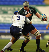 2005/06, European Challenge Cup, Exiles captian. Bob Casey holds off Patrick Blanco, to pass the ball as London Irish vs Agen,  at the Madejski Stadium, Reading, ENGLAND   © Peter Spurrier/Intersport Images - email images@intersport-images..   [Mandatory Credit, Peter Spurier/ Intersport Images].