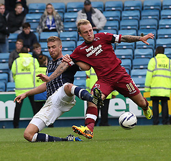 Derby County's Johnny Russell vies for possession with Millwall's Mark Beevers - Photo mandatory by-line: Robin White/JMP - Tel: Mobile: 07966 386802 14/09/2013 - SPORT - FOOTBALL -  The Den - London - Millwall V Derby County - Sky Bet League Championship