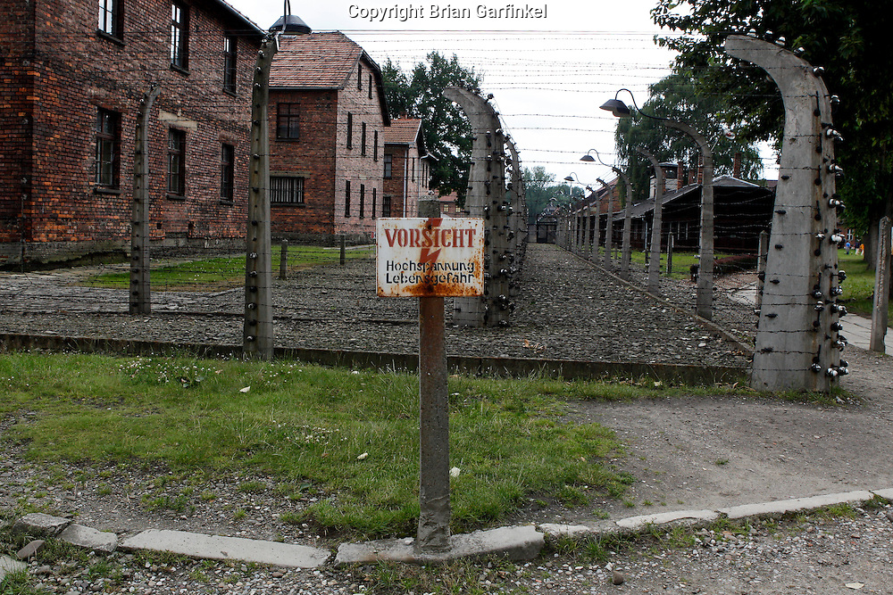 An electric fence warning at Auschwitz Concentration Camp in Poland on Tuesday July 5th 2011.  (Photo by Brian Garfinkel)