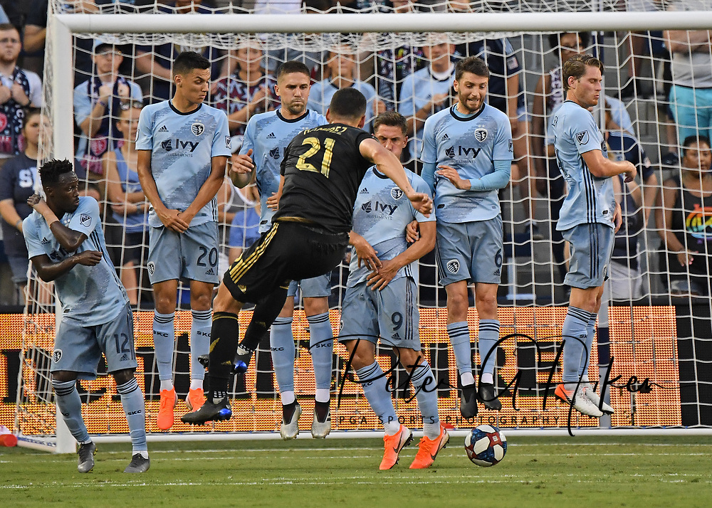 Los Angeles FC forward Christian Ramirez (21) puts the free kick under the Sporting Kansas City wall for a goal during the first half at Children's Mercy Park.
