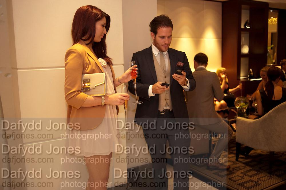 DANIELLE BIGAIGNON; ADAM RYAN, The London Bar and Club awards. Intercontinental Hotel. Park Lane, London. 6 June 2011. <br /> <br />  , -DO NOT ARCHIVE-© Copyright Photograph by Dafydd Jones. 248 Clapham Rd. London SW9 0PZ. Tel 0207 820 0771. www.dafjones.com.