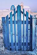 Oia, Santorini Island, Greece: blue gate, wired shut