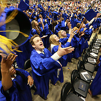 Tupelo High School graduates toss their mortar boards into the air after officially becoming graduates Froday night at the BancorpSouth Areana.