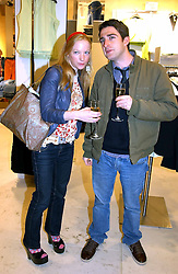Actress NATALIE PRESS and friend DAVID at a party to celebrate the opening of the new H&M Flagship Store at 17-21 Brompton Road, London SW3 on 23rd March 2005.<br /><br />NON EXCLUSIVE - WORLD RIGHTS