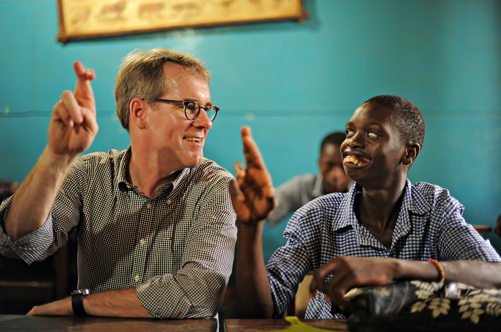 Rainer Brockhaus, director of CBM Germany, learns his name in sign language from Ecole Ephphatha pour les Sourds du Togo student Jean-Claude Djiko.