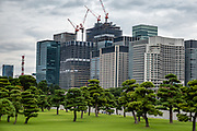 Skyscrapers rise above Tokyo Imperial Garden, Japan. Tokyo Imperial Palace and Garden, the current residence of Japan's Imperial Family. The current Imperial Palace is on the former site of Edo Castle, a large park area surrounded by moats and massive stone walls in the center of Tokyo, a short walk from Tokyo Station. Edo Castle was formerly the seat of the Tokugawa shogun who ruled Japan from 1603-1867. In 1868, the shogunate was overthrown, and the country's capital and Imperial Residence were moved from Kyoto to Tokyo. In 1888 construction of a new Imperial Palace was completed. The palace was once destroyed during World War Two, and rebuilt in the same style, afterwards.