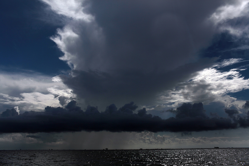 Oil platforms line the horizon in the Gulf of Mexico on July 20, 2010.