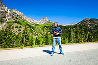 John McElhatton, Photo Assistant extraordinaire, watching for traffic, guarding the lenses, and standing in for light / exposure test. Washington Pass, Highway 2 near Cutthroat Peak (in background).