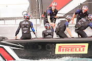 The Great Sound, Bermuda. 10th June 2017. Emirates Team New Zealand sailors congratulate one another after beating Artemis Racing (SWE) in the third race of the Louis Vuitton America's Cup Challenger playoff finals.