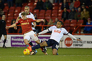 Bolton Wanderers midfielder Neil Danns tackles Nottingham Forest striker Jamie Ward during the Sky Bet Championship match between Nottingham Forest and Bolton Wanderers at the City Ground, Nottingham, England on 16 January 2016. Photo by Alan Franklin.