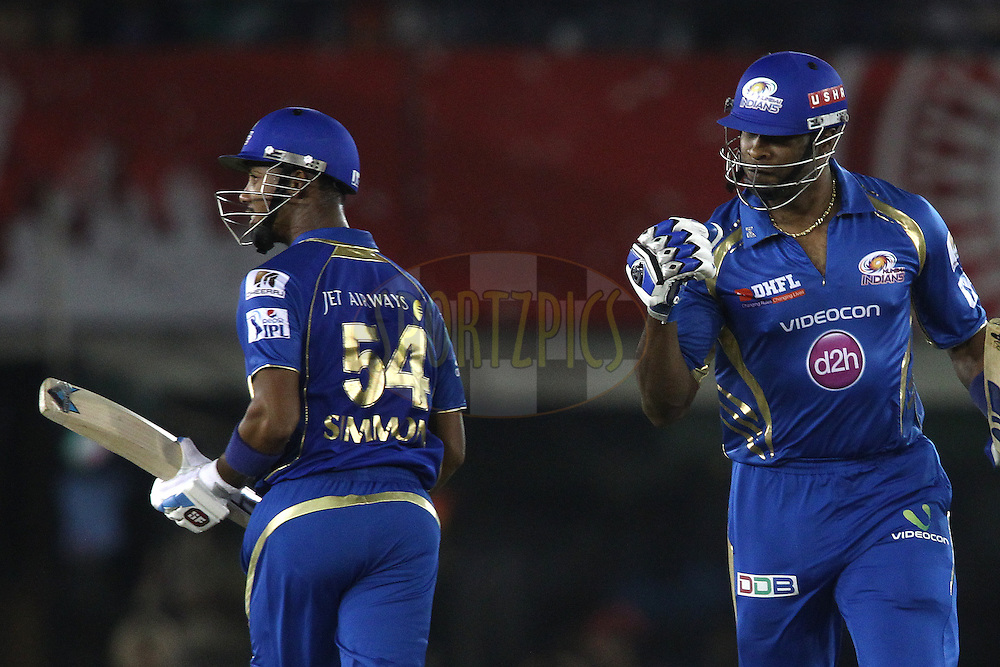 Kieron Pollard of the Mumbai Indians celebrates Lendl Simmons of the Mumbai Indians reaching his hundred as they cross during match 48 of the Pepsi Indian Premier League Season 2014 between the Kings XI Punjab and the Mumbai Indians held at the Punjab Cricket Association Stadium, Mohali, India on the 21st May  2014<br /> <br /> Photo by Shaun Roy / IPL / SPORTZPICS<br /> <br /> <br /> <br /> Image use subject to terms and conditions which can be found here:  http://sportzpics.photoshelter.com/gallery/Pepsi-IPL-Image-terms-and-conditions/G00004VW1IVJ.gB0/C0000TScjhBM6ikg