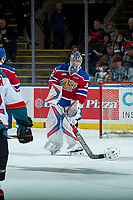 KELOWNA, CANADA - FEBRUARY 17: Todd Scott #35 of the Edmonton Oil Kings uses his stick to slide the helmet of Liam Kindree #26 of the Kelowna Rockets on February 17, 2018 at Prospera Place in Kelowna, British Columbia, Canada.  (Photo by Marissa Baecker/Shoot the Breeze)  *** Local Caption ***