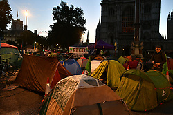© Licensed to London News Pictures. 08/10/2019. London, UK. Tents belonging to Extinction Rebellion activists are seen at first light near Parliament Square in Westminster. Activists have converged on Westminster for a second day, blockading roads in the area and calling on government departments to 'Tell the Truth' about what they are doing to tackle the Emergency. Photo credit: Ben Cawthra/LNP