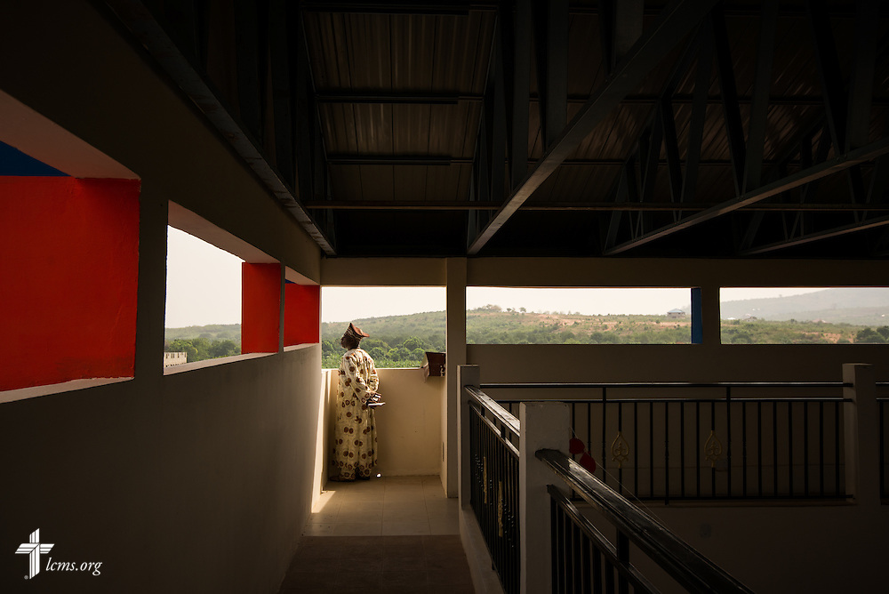 A man peers from the top floor of the Lutheran Theological Seminary of the Evangelical Lutheran Church of Ghana on Sunday, Feb. 2, 2014, in Greater Accra, Ghana. LCMS Communications/Erik M. Lunsford