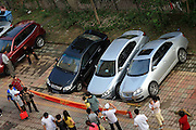 QINHUANGDAO, CHINA - SEPTEMBER 07: (CHINA OUT) <br /> <br /> Three cars are trapped in a hole after a cave-in happened at a residential community on Qinhuangdao, Hebei Provicne of China. <br /> ©Exclusivepix