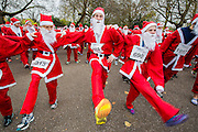 The London Santa Run with around 2,000 Santa's a 6k festive charity fun run. It  is organised to raise funds for Disability Snowsport UK, a national charity helping people with disabilities to access the thrill of snowsports. Battersea Park, London, UK 07 Dec 2013.