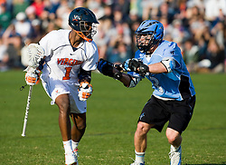 Virginia midfielder Shamel Bratton (1) is defended by Johns Hopkins midfielder Andrew Miller (3).  The #2 ranked Virginia Cavaliers defeated the #6 ranked Johns Hopkins Blue Jays 13-12 in overtime at the University of Virginia's Klockner Stadium in Charlottesville, VA on March 22, 2008.  The loss, in front of a record UVA crowd of 7,500, was the third consecutive overtime defeat for Hopkins, the defending national champions.