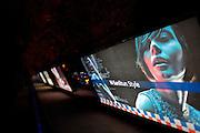 Sanlitun bar street nightlife district. Backlit billboards.