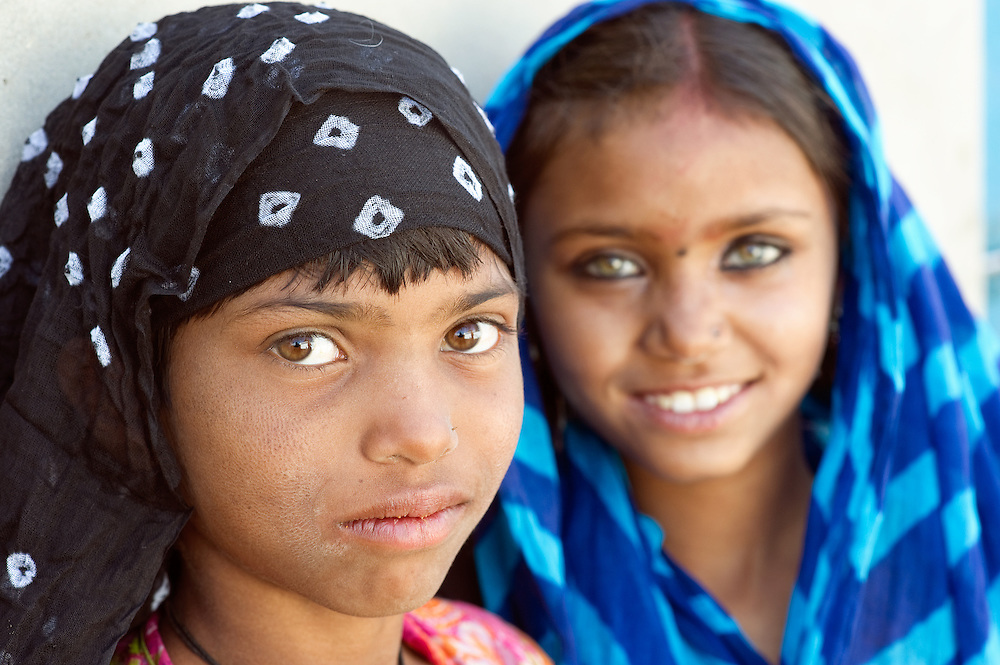 Two girls belonging to the Bhopa tribe: musicians singing Pabu-ji story, a local hero. Used to be nomads, now often living in one village and being replaced by television, the search other sources of income.